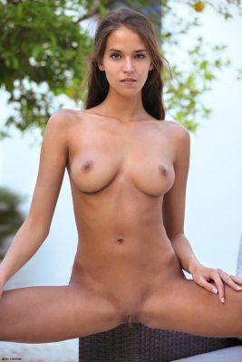 Naked girl in the garden