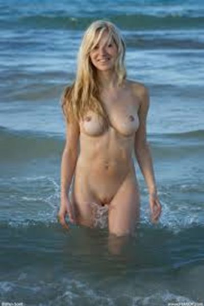 Busty naked girl on the beach |