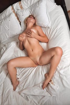 Naked girl plays with herself