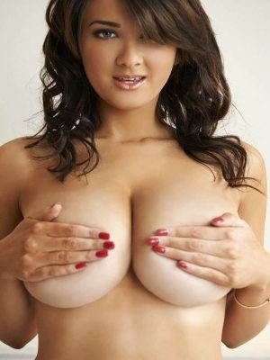 Busty naked brunette
