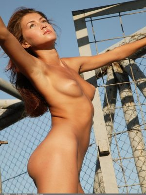 Naked girl by cage