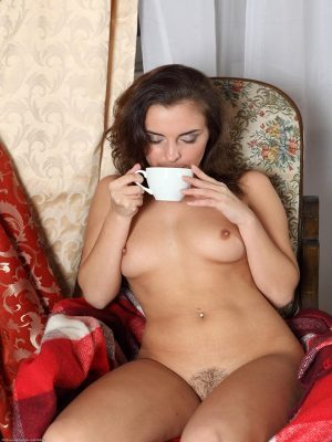 Naked girl drinking tea