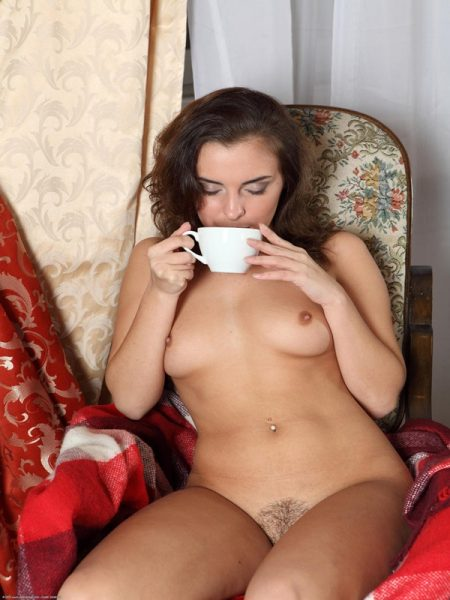 Young and naked girl with small breast and hairy pussy is siting in ...: www.nudegirlspicture.com/naked-girl-drinking-tea
