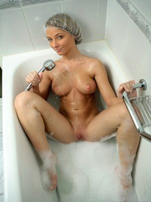 Naughty Abby washing pussy