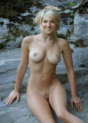 Nude girl siting on the rocks