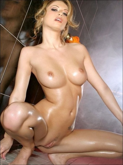 Oiled naked horny blonde