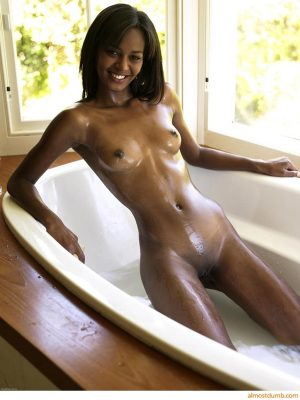 Pretty ebony girl in the bath