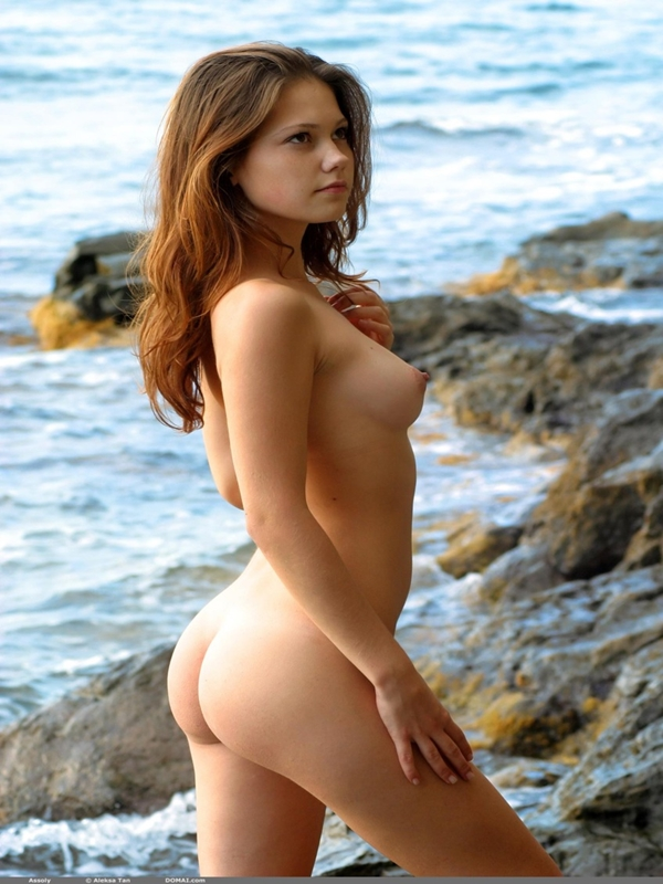 Redhead naked girl on the beach
