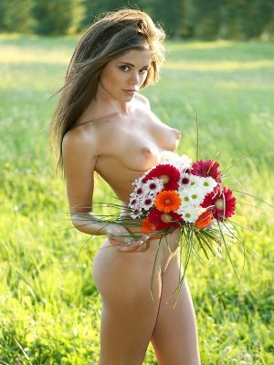 Skinny naked girl with flowers