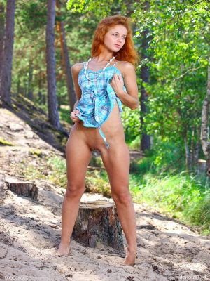 Teen girl stripping in the forest