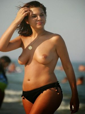 Topless woman on the beach