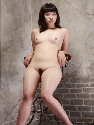 Asian babe siting naked