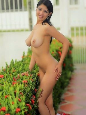 Busty sexy Latina model posing naked outside