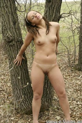 Nude girl in the forest