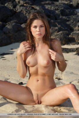 Nude girl on beach sand