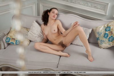 Nude girl on sofa with hairy pussy