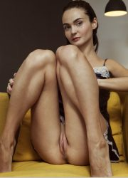 Nude girl pussy on yellow chair