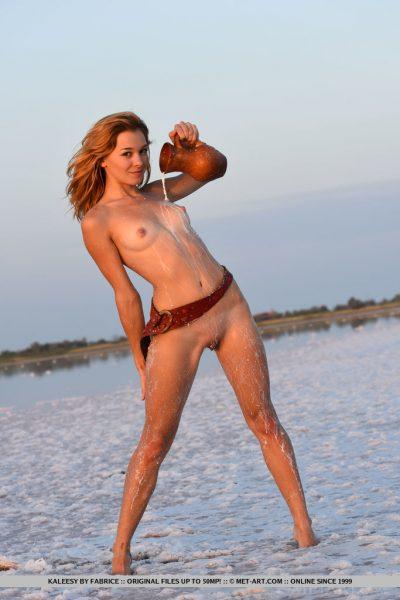 Sexy redhead nude girl on the beach